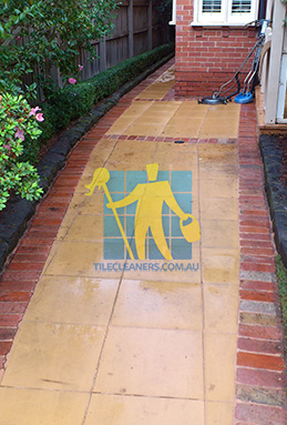 outdoor sandstone tiles pavers wet from cleaning with quarry tiles around Ocean Reef